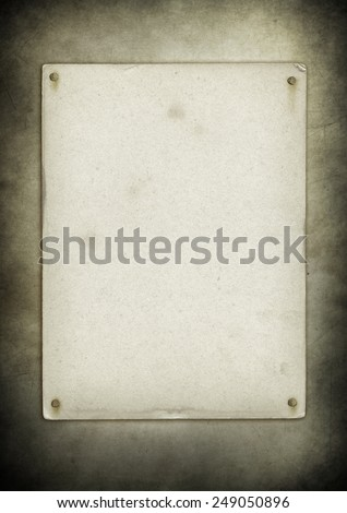 Blank old poster nailed on a grunge wall texture - stock photo