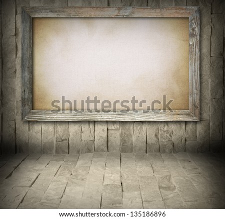 Blank old wooden board on stone wall background - stock photo