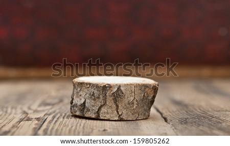 blank old wooden stump on wooden table - stock photo