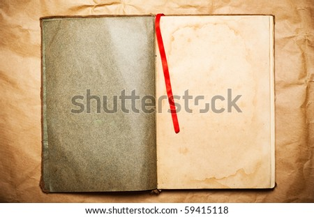 blank open book on yellow paper - stock photo