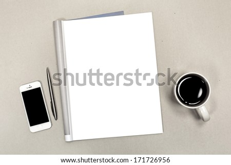 Blank open magazine isolated on textured background with phone and cup of coffee - stock photo
