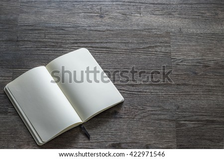 Blank open pocket book, catalog, magazine, brochure note template paper texture on dark grey color wood table wooden floor background: Empty textured note book pages on timber backdrop for adding text - stock photo