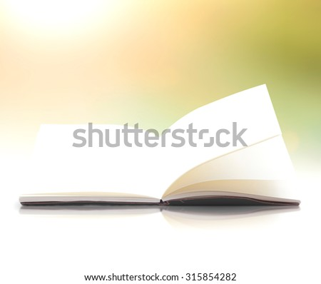 Blank opened magic book, diary, photo album with reflection on white table over blurred beautiful sunrise background. - stock photo