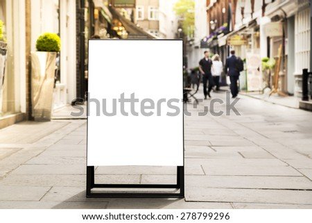 blank outdoor white board at a sidewalk restaurants advertising  - stock photo