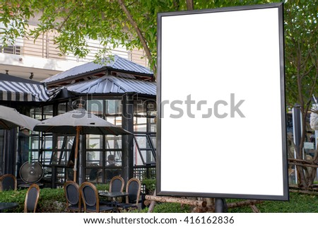Blank outdoor white board at a sidewalk restaurants advertising. - stock photo