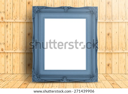 Blank pale blue Vintage frame on wood floor and plank wooden wall,Template mock up for adding your design. - stock photo