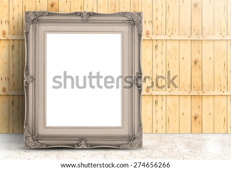 Blank pale brown Vintage frame on marble floor and plank wooden wall,Template mock up for adding your design. - stock photo