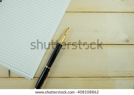 blank paper and pen on wood background - stock photo