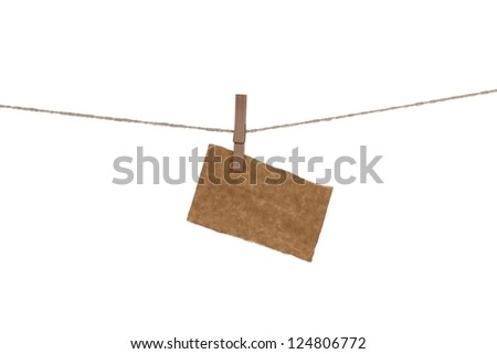 Blank paper cards hanging on clothespins - stock photo