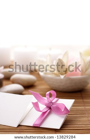 blank paper, flowers and candles. invitation, greeting card, business card