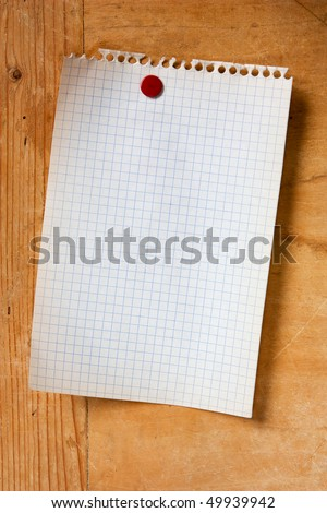blank paper note, old torn piece of notebook paper attached with red push pin  - stock photo