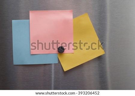 BLANK PAPER NOTE ON STAINLESS STEEL REFRIGERATOR DOOR  - stock photo