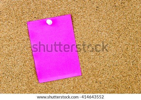 Blank paper note pinned on cork board with thumbtack, copy space available