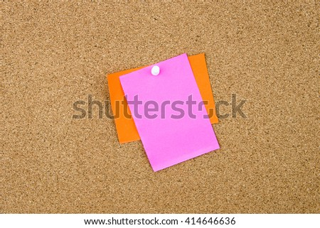 Blank paper notes pinned on cork board with thumbtack, copy space available
