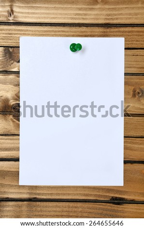 blank paper on wood background - stock photo