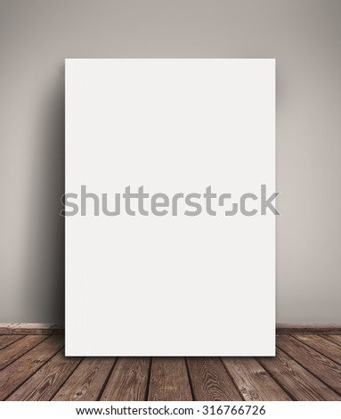Blank Paper Poster Mock Up Leaning Against  Gray Wall as Copy Space for Design and Text. - stock photo