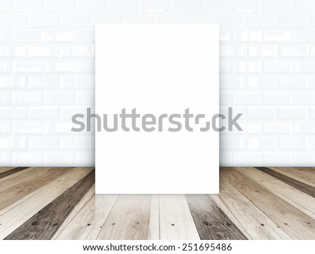 Blank paper poster on white ceramic tiles wall and tropical wood floor,template for your content - stock photo