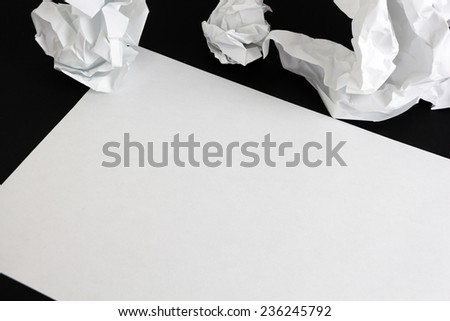 Blank paper sheet and crumpled papper balls isolated - stock photo