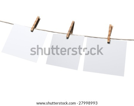 blank paper sheet hanging on a rope - stock photo
