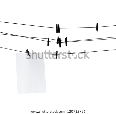 Blank paper sheet on clothesline with clothespins - stock photo