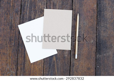 Blank paper with letter and pencil on wooden table. - stock photo
