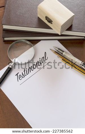 Blank paper with Testimonial word. - stock photo