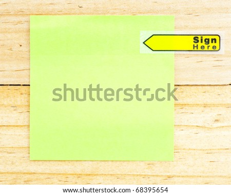 Blank paper with the clip on the wooden background - stock photo