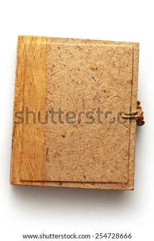 Blank photo album with wooden cover on white - stock photo
