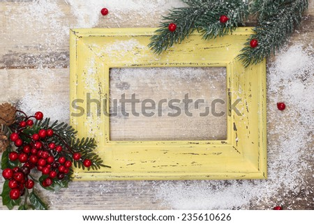 Blank photo frame and Christmas decoration. Vintage frame and Christmas decoration on old rusty background.  Copy space for your text. - stock photo