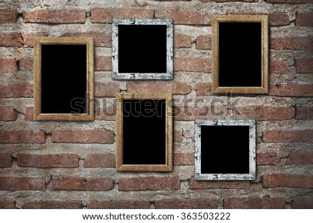 blank photo frame hanging on old wall - stock photo