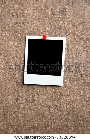 Blank photo frame on a wall - stock photo