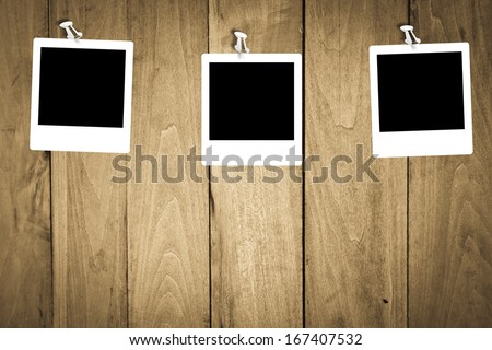 blank photo frames for your photos on wooden background. polaroid frame  - stock photo