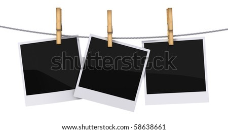 Blank photo frames hanging on a rope - stock photo