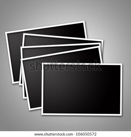 Blank photo frames isolated on grey  background - stock photo