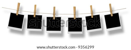 Blank photo frames on a leash. In front of a white background (with clipping path). - stock photo