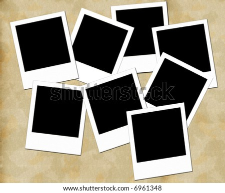 Blank photo frames on aged paper background