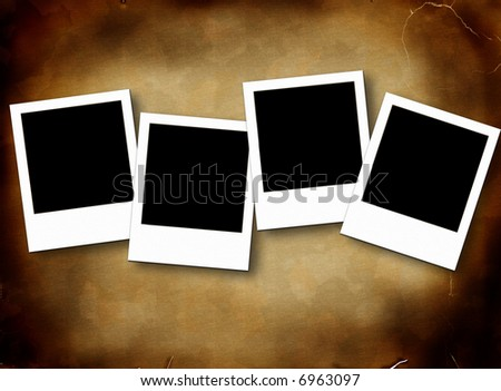 Blank photo frames on aged rusty background