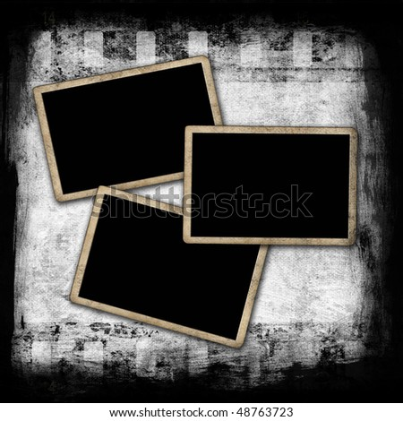 Blank photo frames on grunge wall with film strip - stock photo