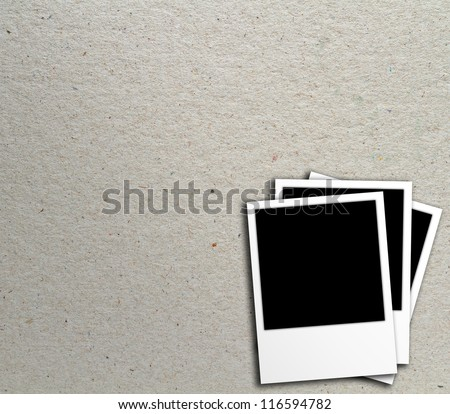 Blank photo frames on recycle paper