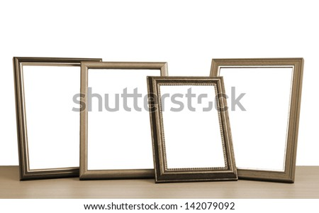 blank photo frames on the table - stock photo