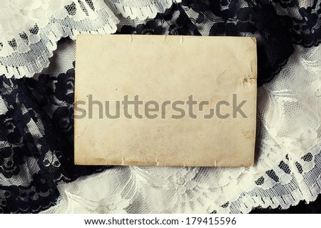 Blank photo paper on vintage background - stock photo