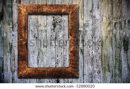 blank photoframe on old wooden background
