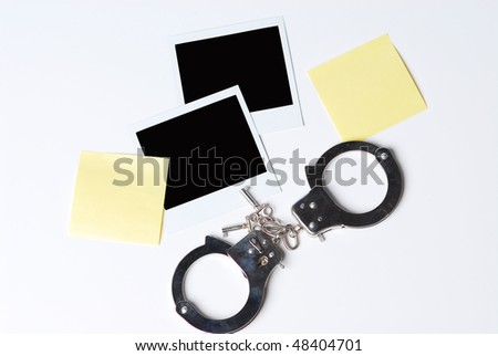 blank photos and handcuffs