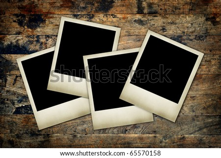 blank photos on a wood background