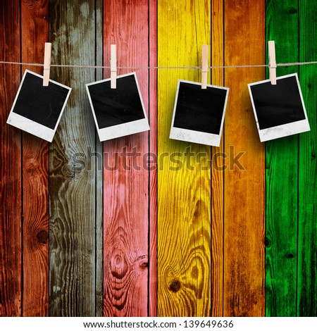 Blank Photos on Multicolored Wood Background - stock photo