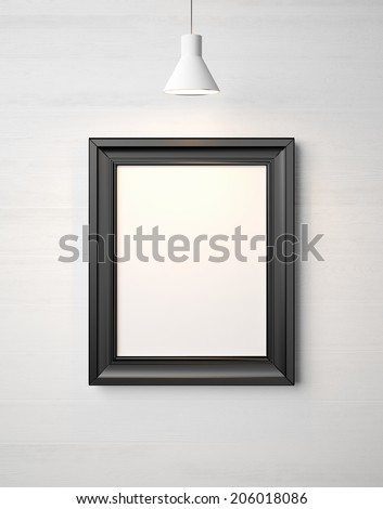 Blank picture frame on a wall - stock photo