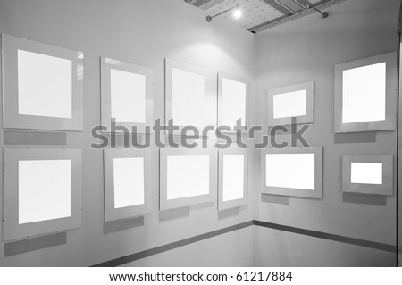 Blank picture frames in art gallery to be filled - stock photo