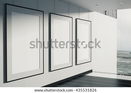Blank picture frames in room with concrete wall, black floor and window with seaside view. Mock up, 3D Rendering
