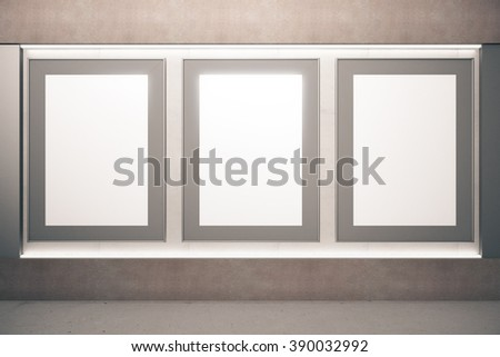 Blank picture frames on brown wall in empty room, mock up - stock photo