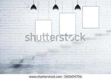 Blank picture frames on white brick wall, lamps and stairs, mock up - stock photo